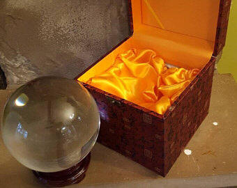 large real crstal ball, box, stand and instructions on how to read a crystal ball